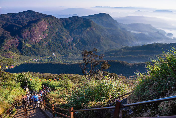Adams Peak (Sri Pada) , pilgrims climbing the 5200 steps to the summit, Central Highlands of Sri Lanka, Asia. This is a photo of pilgrims climbing the 5200 steps to the summit of Adams Peak (Sri Pada) in the Central Highlands of Sri Lanka. Pilgrims often start at about 2am in order to climb the 5200+ steps to the summit of Adams Peak (Sri Pada) in time to watch the sunrise.